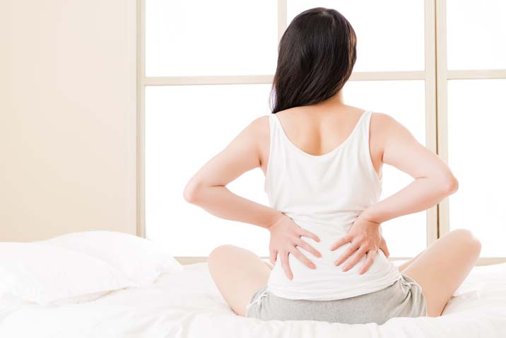 Woman with low backache