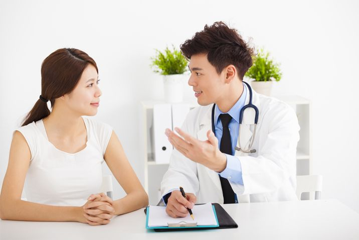 Patient discussing with doctor