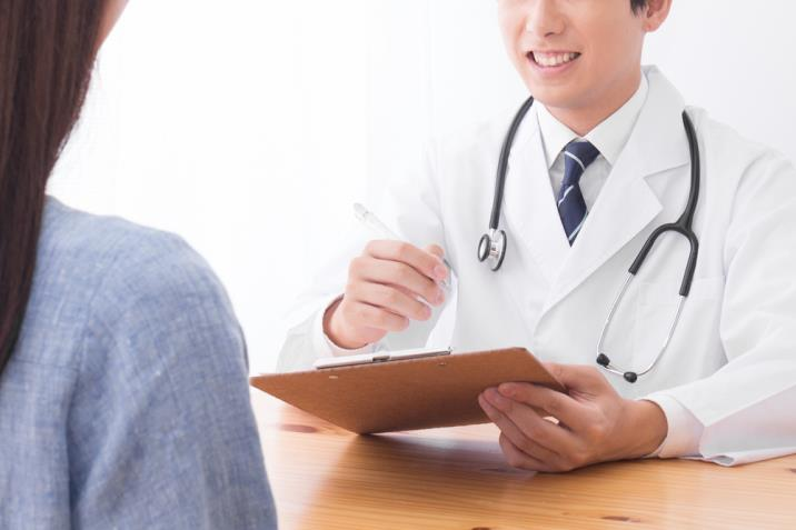 doctor advising patient on treatment options