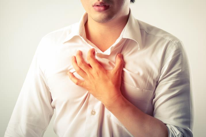man having chest pain