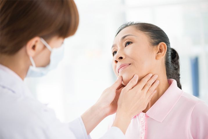 checking a lump in the neck